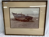 Framed photo of  a jollyboat on shore