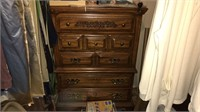 chest of drawers, clothing,chairs, radio