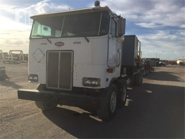 Lot # 205 - 2002 2002 PETERBILT 362 TWIN STEER CAB OVER POWERED BY