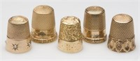 Approximately 100 gold thimbles