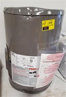 Small Rheem 10gal Elect Water Heater.  Dented on