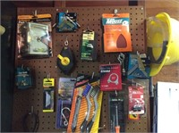 Pegboard of Brushes, Clamps, Chain, Bulbs