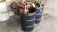 Two barrels of cut wood scraps