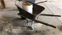 Wheelbarrow with bucket of rope