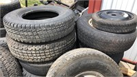 Two pallets of tires some with rims