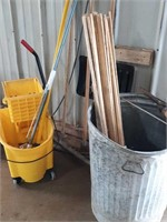 Commercial mop bucket with mops, trash can,