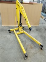 "2 Ton Engine Hoist. 62"" X 36"" X 60""."