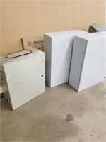 Four electrical panel enclosures.