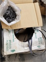 Plastic strapping with clips and shrink wrap