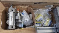 Assorted pneumatic cylinders and hardware.