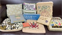 Collection of 11 embroidered pillows and seats