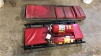 Two mechanics creepers (Napa) fire extinguishers