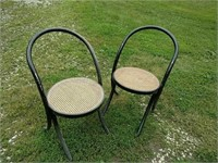 Pair black backless parlor chairs, caned seats