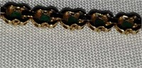 14K yellow gold emerald bracelet 7.6 grams