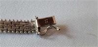 """14 K white gold mesh style bracelet """"IG"""""""