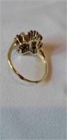 14k yellow gold round & bagg. Diamond cluster ring