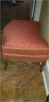 Bowed shaped peach in color ottoman