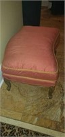 Bowed peach in color ottoman