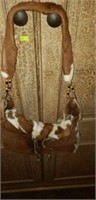 Cowhide hand bag with wooden beads