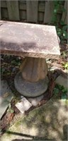2 concrete fountain bases with concrete bench