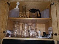 Cabinet of Glass Pitchers, Coffee Pot, Etc
