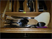 Drawer full of Kitchen Utensils