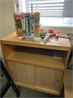 Shop Cabinet with Caulking and Guns