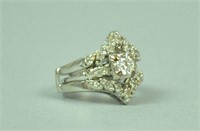 DIAMOND ENGAGEMENT RING AND A JACKET, 1.00CTW