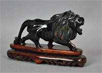 CHINESE CARVED TIGER EYE LION SCULPTURE