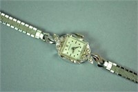 LADIES BENRUS GOLD CASE WATCH WITH DIAMONDS