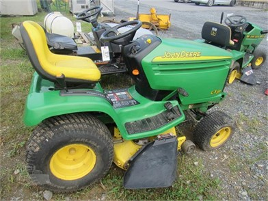 JD LX280 RIDING MOWER W/SNOW THROWER (RUNS) Other Auction