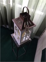 Candle In A Hanging Cage But Presently On A