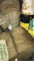 Chemical cans, burlap bags, pipe fittings +