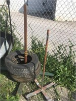 2 Tires & 2 Mobile Tire Stands