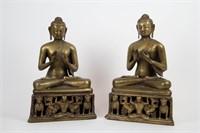 Pair of Brass Buddhas Seated on Lion Platforms.