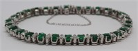 JEWELRY. Platinum, Diamond and Emerald Bracelet.