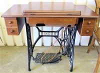 Singer Treadle Sewing Machine in Cabinet (view 1)