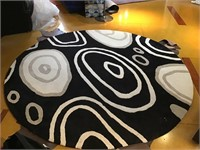 Round geometric area rug