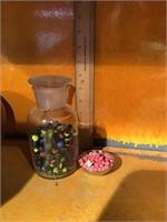 Jar full of mini marbles bowl full of mini die