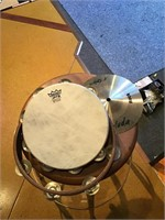 Two tambourines and a cymbal
