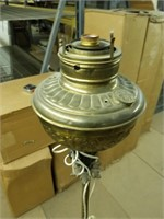 Electrified gas lamp on stand.