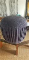 Fabric covered purple ottoman