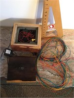 Custom made wood box with spaghetti lites