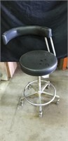 Black upholstered doctors rolling chair