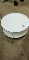 Small white round coffee table on wheels