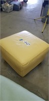 Yellow leather ottoman