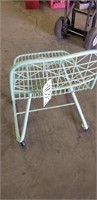 Seafoam green wire metal chair with wheels