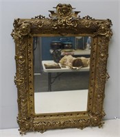 Antique Rococo Brass Mirror With Figural Crown.