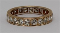 JEWELRY. 18kt Gold and Diamond Eternity Band.