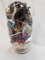 Clear Glass Vase Full Of Costume Jewelry
